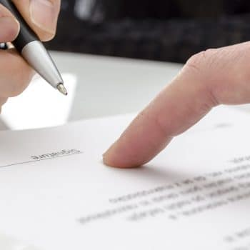 Woman signing a paper